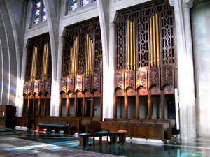 The pipes of the new small organ are located in the existing chancel organ chamber.